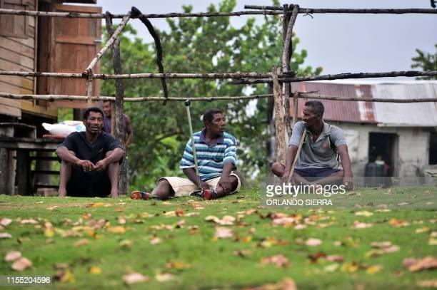 Disabled divers Willy Pamista Mileno Lopez Benedith and Jaime Lemus Matute chat in Prumnitara Puerto Lempira Honduras on July 8 2019 Thousands of...