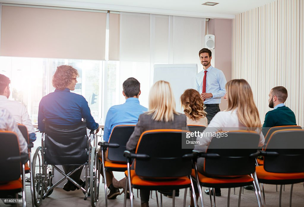 Disabled employee attending meeting in conference room : Foto de stock
