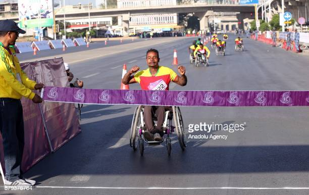 Disabled Ethiopian athlete Demesew Abera finishes first in the men's Great Ethiopian Run at Adwa Square in Addis Ababa Ethiopia on November 26 2017...