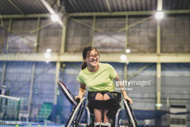 Disabled female athlete playing wheel chair tennis