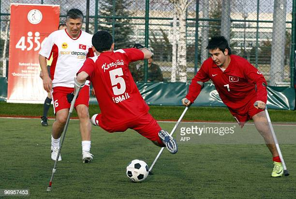 Disabled football players belonging to a Turkish amputee football team whose members are soldiers wounded in the line of duty train during a practice...