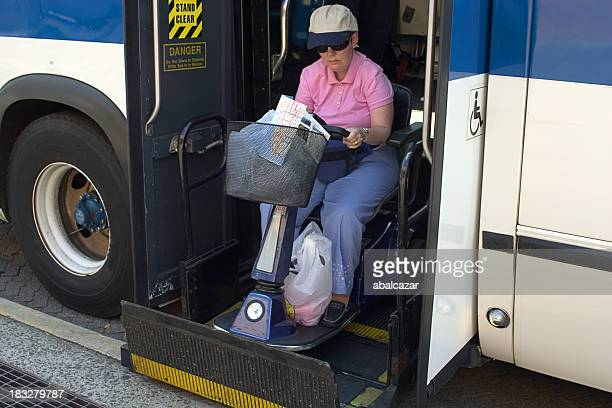 disabled getting into the bus - mobility scooter stock photos and pictures