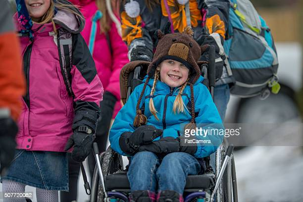 Disabled Girl Being Pushed in Her Wheelchair