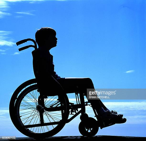 Disabled girl, boy, aged 11 years in wheel chair
