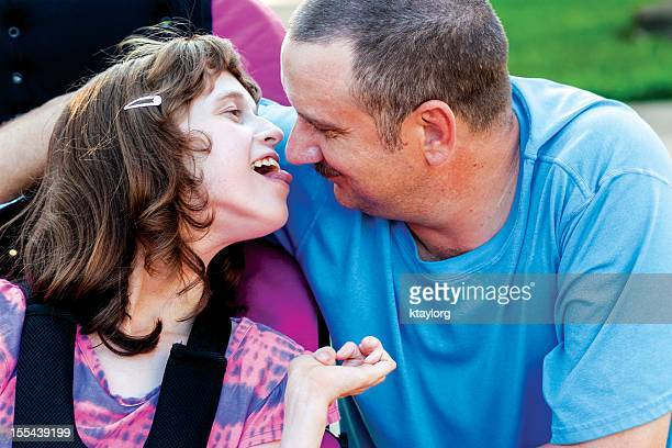 Disabled girl giving Daddy a kiss