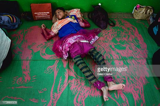 A disabled girl lies on the floor of the Chingari Trust's rehab center for children November 29 2012 in Bhopal India The Chingari Trust serves as a...