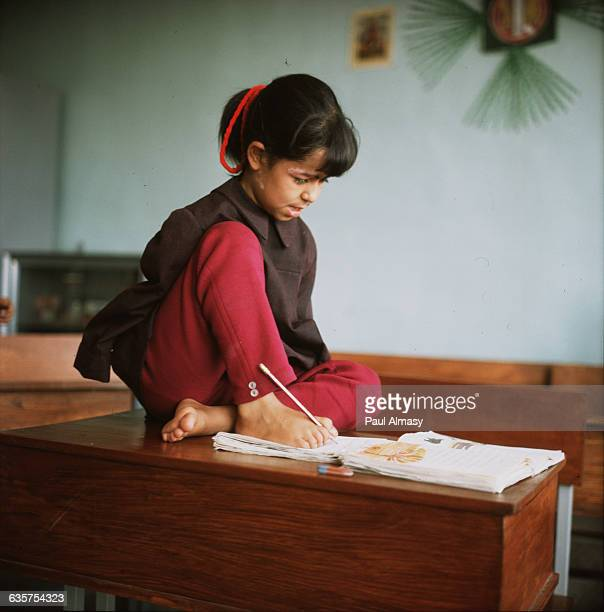 Disabled Girl Writing with Feet