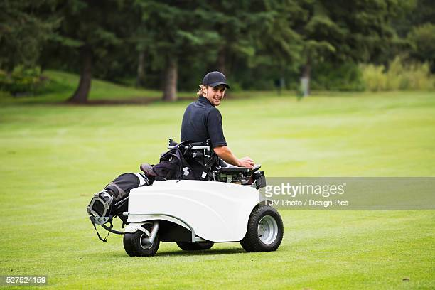 Disabled golfer in a tournament using high tech mobility aid