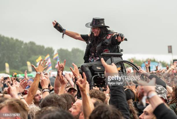 Disabled heavy metal fan goes crowd surfing in a wheelchair at Bloodstock Festival 2021 at Catton Hall on August 15, 2021 in Burton Upon Trent,...
