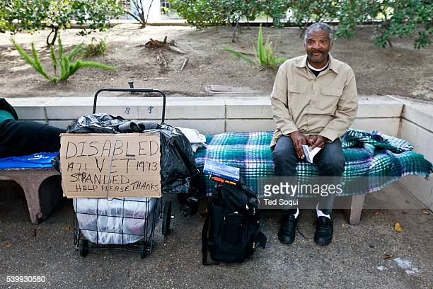 A disabled homeless Vietnam Veteran with his camp in downtown LA