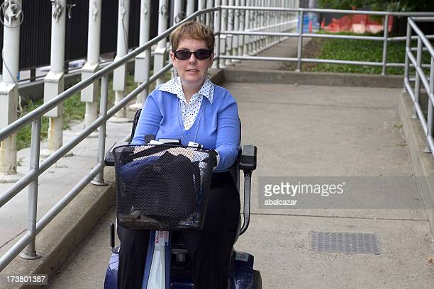 disabled in ramp - mobility scooter stock photos and pictures