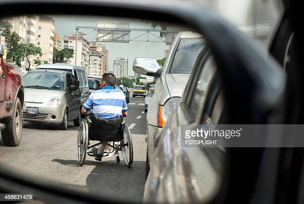 disabled in the middle of street between cars. - fstoplight stock photos and pictures