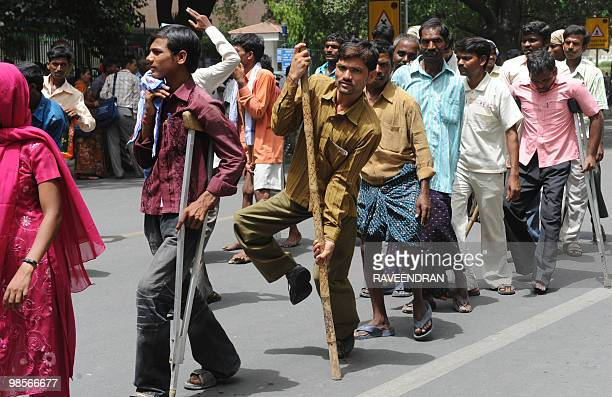 Disabled Indian citizens some walking with the aid of crutches take part in a protest march to parliament in New Delhi on April 20 2010 Thousands of...