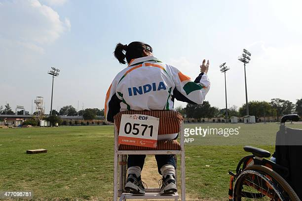 Disabled Indian sportswoman Deepa Malik gestures as she attends an athletics practice session at The Jawaharlal Nehru Stadium in New Delhi on March 5...