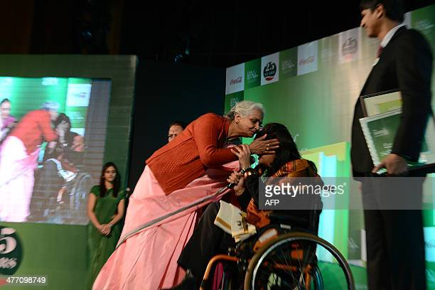 Disabled Indian sportswoman Deepa Malik is embraced by her mother as she attends an awards ceremony in New Delhi on March 6 2014 Malik who is a...