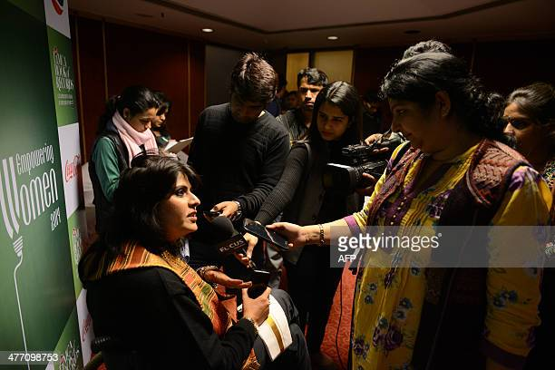 Disabled Indian sportswoman Deepa Malik is interviewed by media representatives after attending an awards ceremony in New Delhi on March 6 2014 Malik...