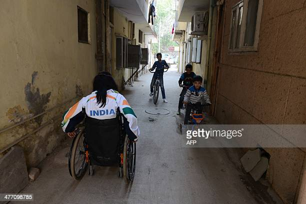 Disabled Indian sportswoman Deepa Malik leaves her home in New Delhi on March 5 for a athletics practice session Malik who is a paraplegic combines...