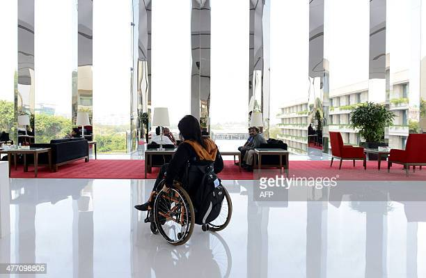 Disabled Indian sportswoman Deepa Malik prepares for a magazine photo shoot at a hotel in Gurgaon on the outskirts of New Delhi on March 4 2014 Malik...
