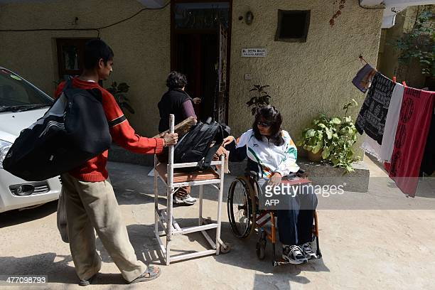 Disabled Indian sportswoman Deepa Malik prepares to leave her home in New Delhi on March 5 for a athletics practice session Malik who is a paraplegic...