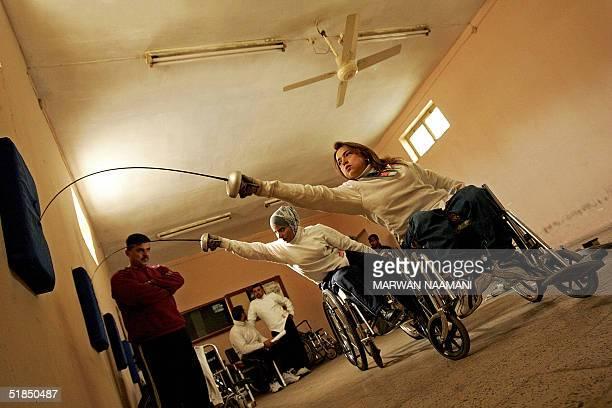 LIFESTYLEIRAQWOMENFENCING Disabled Iraqi fencing players Nadia Ali Abdel Karim and Wafa Jadwal train at alWissam club in Baghdad 11 December 2004...