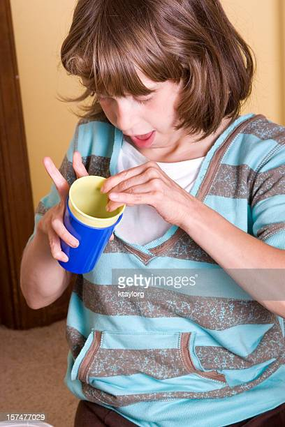 Disabled little girl using cups