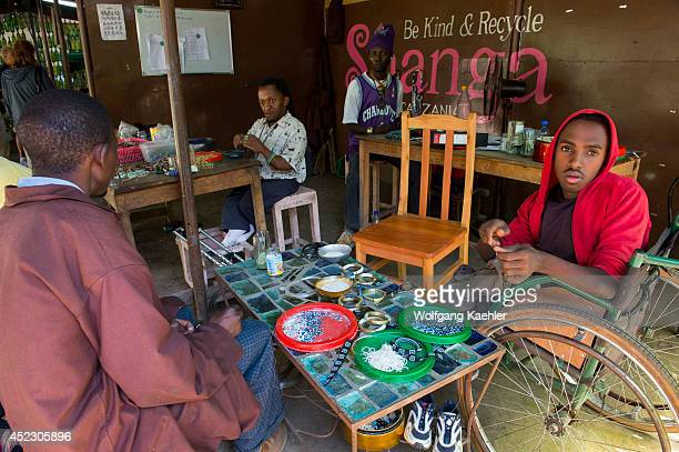 Disabled local people making handicrafts using recycled materials for the wholesale and retail consumer market at the Shanga House in Arusha Tanzania