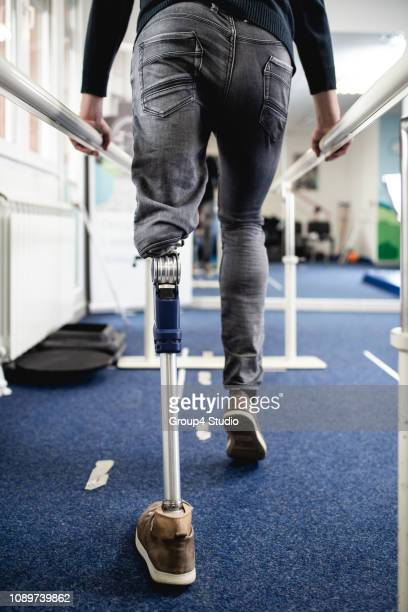 disabled man at physiotherapy center - fake hospital stock pictures, royalty-free photos & images