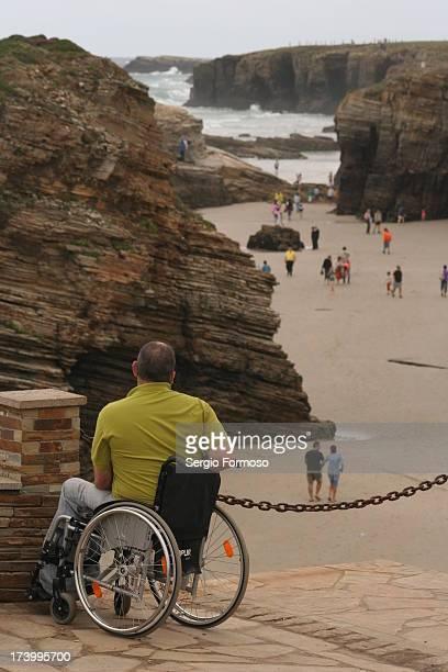 CONTENT] Disabled man at Playa de la Catedrales