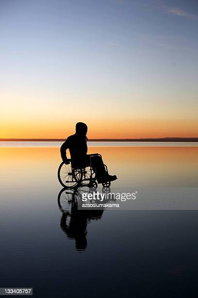 disabled man beyond the sunset