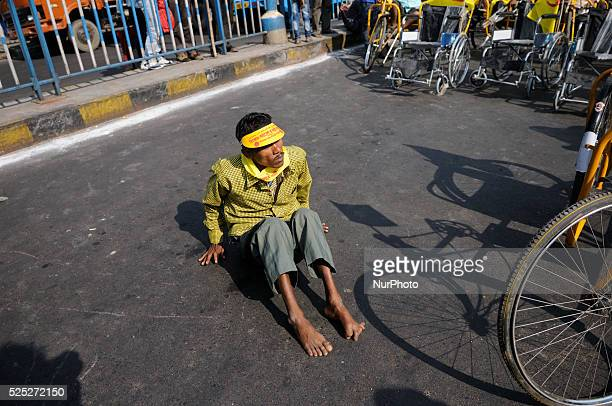 Disabled man crawling during the occasion of World Disability Day in Kolkata, India.
