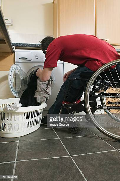 Disabled man doing his laundry