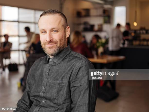 disabled man in a cafe - spinal cord injury stock photos and pictures