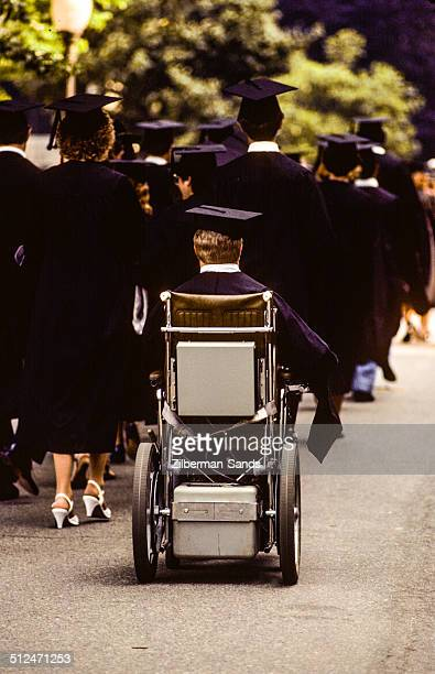 Disabled man in wheelchair at graduation