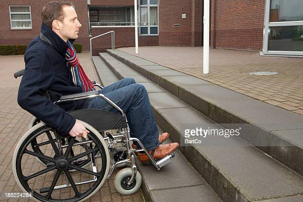 disabled man in wheelchair looking at stairs - flaccid stock photos and pictures