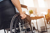 A disabled man is sitting in a wheelchair.