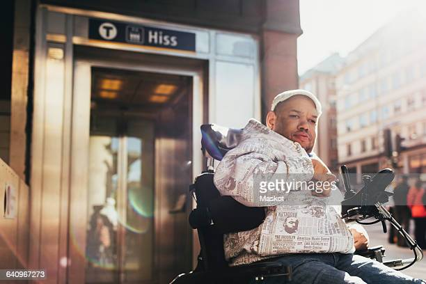 Disabled man on motorized wheelchair in city