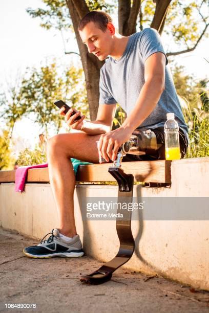 Disabled man resting after jogging