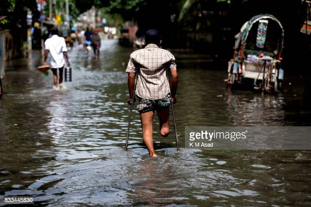 AGRABAD DHAKA CHITTAGONG BANGLADESH A disabled man traveling through a flooded area of Chittagong People traveling in flooded areas in Chittagong...