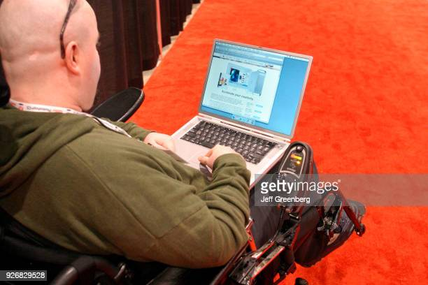 A disabled man using a computer at the Photoshop World technology event