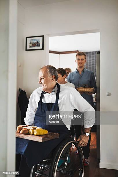 Disabled man with corn and breads at home
