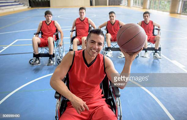 Disabled men playing basketball