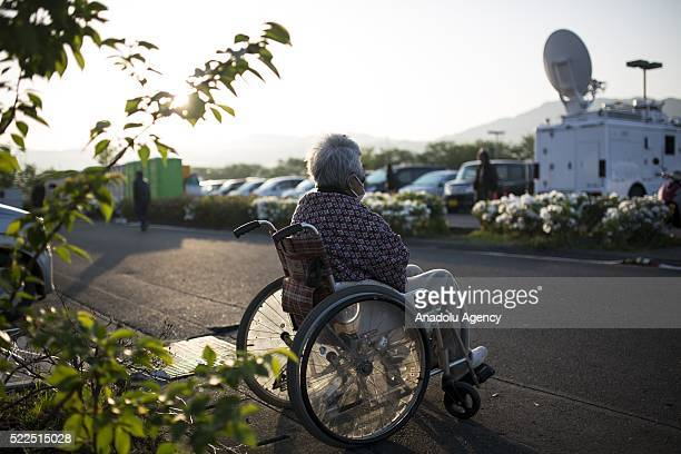 Disabled old woman, survived from earthwuake, sits on her wheelchair on early morning on April 20, 2016 in Mashiki Gymnasium evacuation center,...