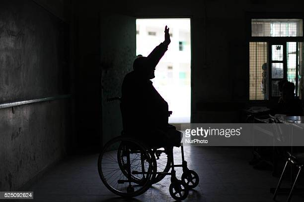 Disabled Palestinian teacher Ahmed alSawaferi who said that he lost his both legs and his left arm in an Israeli air strike in 2008 pushes himself at...