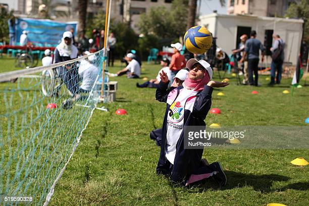 Disabled Palestinians play sitting volleyball during a local sports championship organized by Al Jazeera club in Gaza City April 7 2016