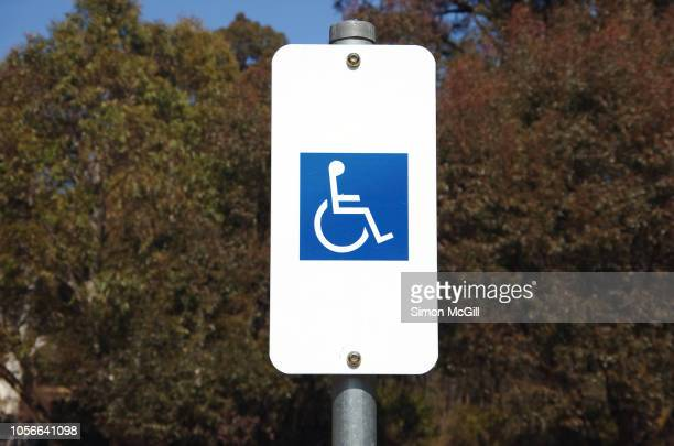 disabled parking sign - disabled sign stock photos and pictures