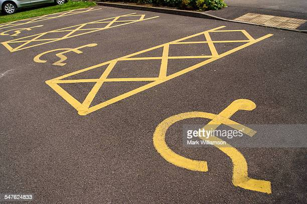 disabled parking spaces - disabled sign stock photos and pictures