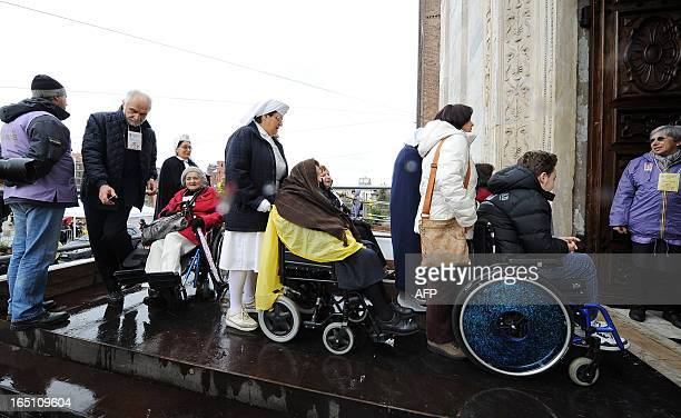 Disabled people arrive at the Turin cathedral to see 'The Shroud of Turin' on March 30 2013 On Holy Saturday the linen cloth imprinted with the faint...