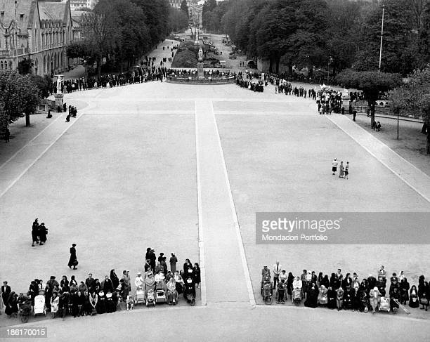 Disabled people waiting in the square of the basilica of Our Lady of the Rosary during the centenary of the apparitions of Our Lady to Saint...
