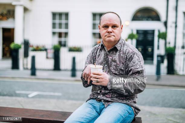 disabled person drinking coffee - learning disability stock pictures, royalty-free photos & images