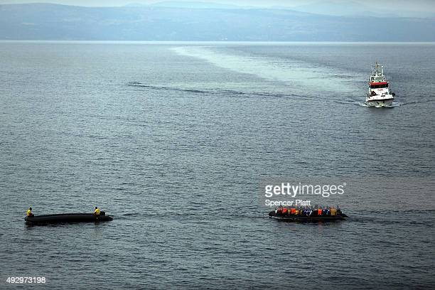 A disabled raft is pulled ashore onto the island of Lesbos on October 16 2015 in Mytilene Greece Dozens of rafts and boats are still making the...